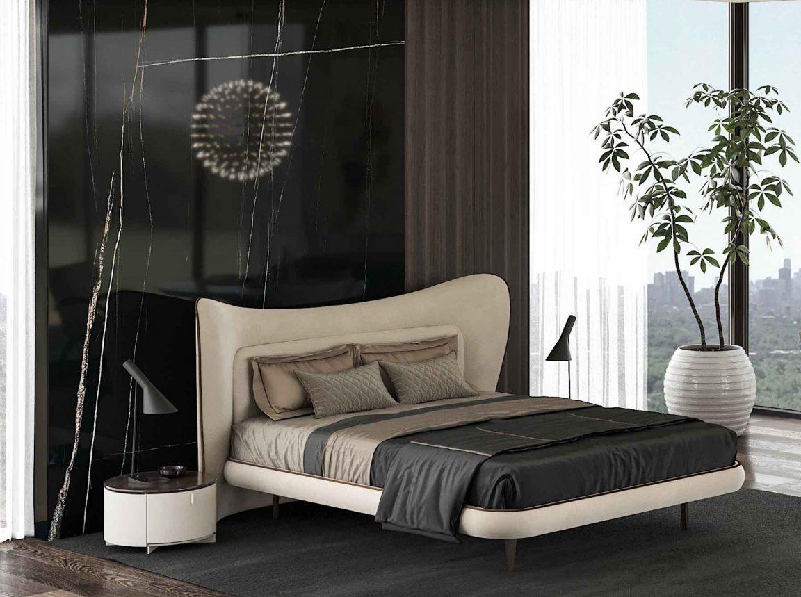 Стильный интерьер спальной с кроватью